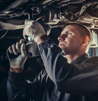 Mechanic working underneath vehicle